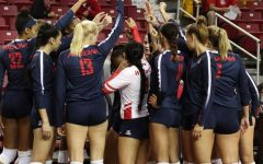 The Arizona Wildcats huddle together before the next set vs. NMSU.
