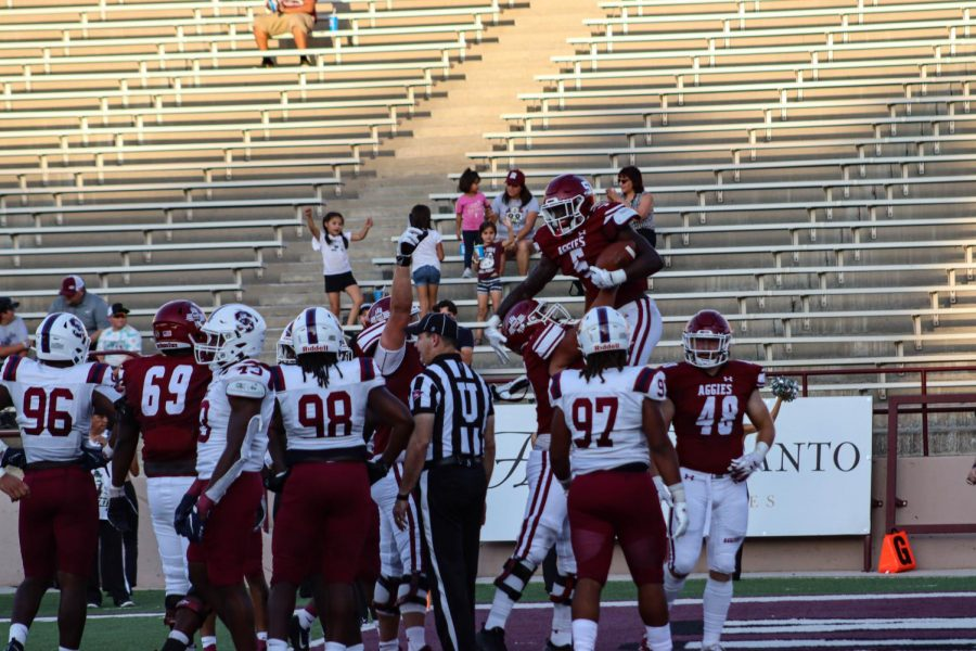 The Aggies celebrate in the end zone after another score against SCSU.