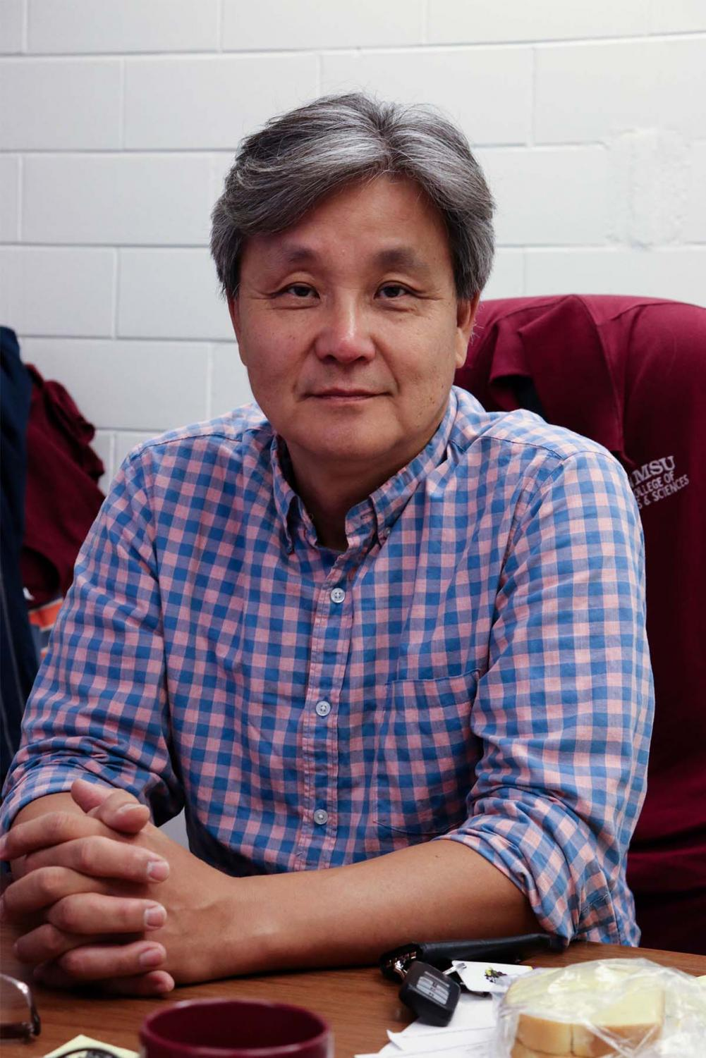 Head of the journalism department and professor, Dr. Hwiman Chung sits in his office in Milton Hall.