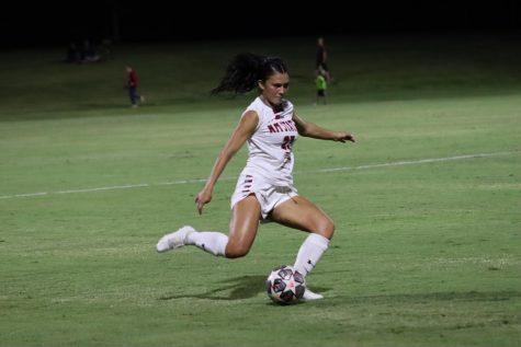 NMSU Womens Soccer defender and senior student, Lece Aviles mid-kick.